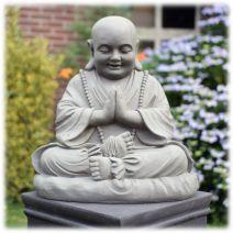 Biddende zittende monnik licht groot