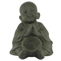 Kind monnik zittend met schaal donker