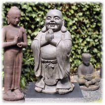 Staande Happy Boeddha groetend donker