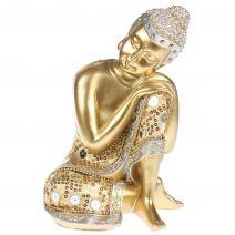 Slapende gouden Boeddha met luxe gewaad